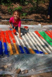 Even 'lil volunteers can paint a difference! She's sprucing up the Atlanta BeltLine.