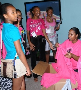 Keshia Knight Pulliam, right, hands out Kamp Kizzy shirts to last year's campers.