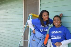 Keisha Knight Pulliam, left, puts the blue tools to work with long-time ToolBank member agency, HouseProud Atlanta.