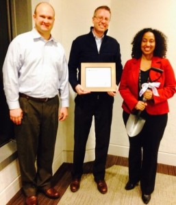 IBM Corporate Citizenship Managers Christian Schoen (center) and LaTjuan Dogan (right) receive Atlanta ToolBank's Corporate Partner of the Year from Board Chairman Brad Sand